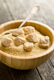 Unrefined cane sugar in bowl Royalty Free Stock Photos