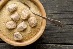 Unrefined cane sugar in bowl Stock Photos