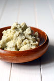 Unrefined shea butter. Unrefined raw shea butter on wooden background Royalty Free Stock Images