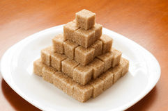 Unrefined sugar on  plate Stock Image