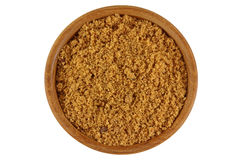 Unrefined unbleached natural Brown sugar in brown color in a woo. Top view of unrefined unbleached natural Brown sugar in brown color in a wooden bowl isolated Stock Photography