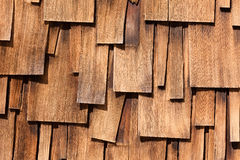 Unregular pattern of Western red cedar shingles. Abstract background of unregular texture pattern of overlapping Western Red Cedar shingles natural organic Royalty Free Stock Image