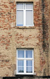 Unrenovated, dirty and and shabby brick wall of an old building Royalty Free Stock Photos