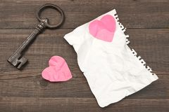 Unrequited Love Concept. Vintage Key, Two Crumpled Heart, Blank Royalty Free Stock Photography