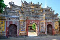 Unrestored ancient gate of Imperial City Hue, Vietnam. Gate of the Forbidden City of Hue. Unrestored ancient Gate of the Imperial City. The gate is part of a royalty free stock photo