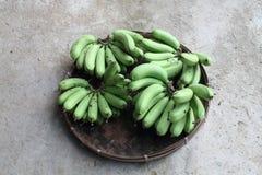 Unripe banana in pannier Royalty Free Stock Photo
