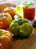 Unripe green ribbed tomato Royalty Free Stock Images