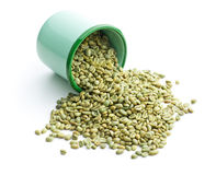 Unroasted coffee beans in green mug Royalty Free Stock Photo