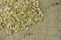 Unroasted coffee beans on hemp background Stock Photo
