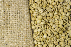 Unroasted coffee beans on hemp background Royalty Free Stock Photography