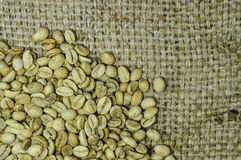 Unroasted coffee beans on hemp background Royalty Free Stock Images