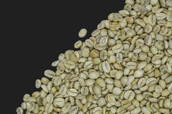 Unroasted coffee beans isolated on black background Royalty Free Stock Image