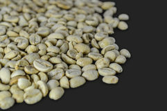Unroasted coffee beans isolated on grey background Royalty Free Stock Photography