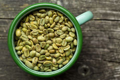 Unroasted coffee beans in mug Royalty Free Stock Photo