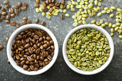 Unroasted and roasted coffee beans Stock Photography