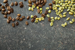 Unroasted and roasted coffee beans Royalty Free Stock Image
