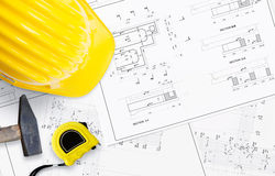 Unrolled construction project on table. Royalty Free Stock Photo