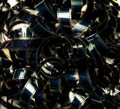 Unrolled heap 35mm movie filmstrip color carpet. Background royalty free stock images