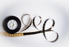 Unrolled 35 mm movie film on white Royalty Free Stock Image
