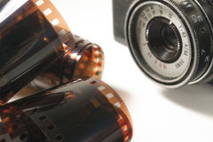 Free Unrolled Photographic Film And Old Camera Royalty Free Stock Photos - 54599798
