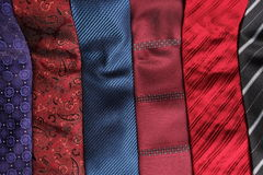 Unrolled ties extended on a table Stock Photography