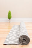 Unrolling carpet in a new home Royalty Free Stock Image