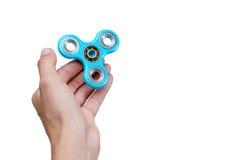 Unruhespinner Blauer Hand-Spinner, beunruhigendes Hand-Spielzeug, das auf Kind-` s Hand sich dreht Entspannung Antidruck und Ents Lizenzfreie Stockfotografie