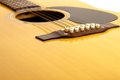 Uns 12 acústicos amarram a guitarra Fotografia de Stock Royalty Free