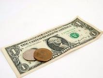 Uns dólar e mudança velhos Fotografia de Stock Royalty Free