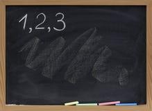 Uns, dois, três números no quadro-negro Foto de Stock