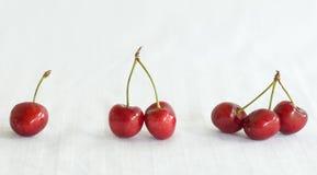 Uns, duas, três cerejas. Imagem de Stock Royalty Free