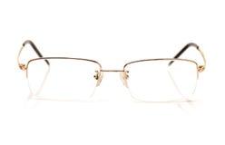 Uns vidros da cor do ouro para a vista maçante Imagens de Stock