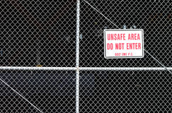 Unsafe area behind a fence with do not enter. Stock Images