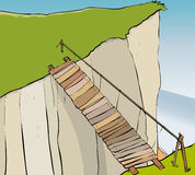 Unsafe bridge. Rickety unsafe bridge spanning a cliff Royalty Free Stock Images