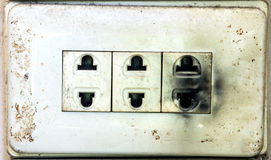 Unsafe burnt electric plug Royalty Free Stock Photo