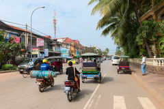 Unsafe road traffic with gas bottle on cambodian street Royalty Free Stock Image
