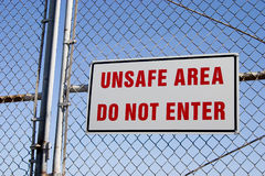 Unsafe Sign 2. Do not go inside this area stock photos