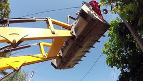 Unsafe Work at Height. Two workers in bulldozer at a dangerous height stock footage