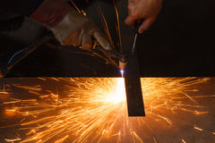 Unsafe work - Using plasma cutting machine without safety protection. Royalty Free Stock Photos