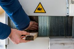 Unsafe working with wood machine stock image