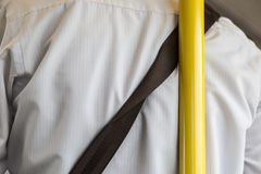 Unsafety man lean on the pole in the train. Royalty Free Stock Photo