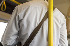 Unsafety man lean on the pole in the train. Stock Images