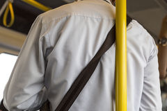 Unsafety man lean on the pole in the train. Stock Photos