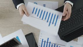 Unsatisfied businessman showing company statistics to manager, crisis at work. Stock footage stock video