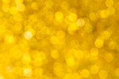 Unschärfegoldlicht bokeh Hintergrund Auszug Lizenzfreie Stockbilder