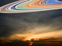 Unschärfesaturn-Ring und Sonnenunterganghimmel Lizenzfreies Stockfoto