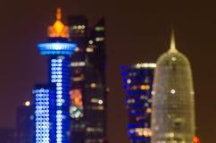 Unscharfe abstrakte Hintergrundlichter Dohas Skyline Lizenzfreie Stockbilder
