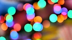 Unscharfe bunte Lichter Rot, gr?n, gelb, Orange, blaues defocused funkelndes bokeh festlicher Hintergrund stock video