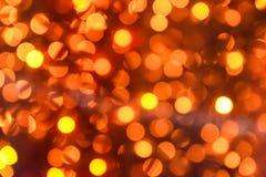 Unscharfe orange Lichter als Hintergrund stockbilder