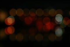 Unscharfe Stadt-Leuchten und Reflexion Lizenzfreie Stockbilder